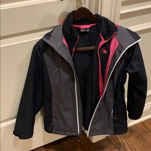 Kids black and pink north face jacket size 1012